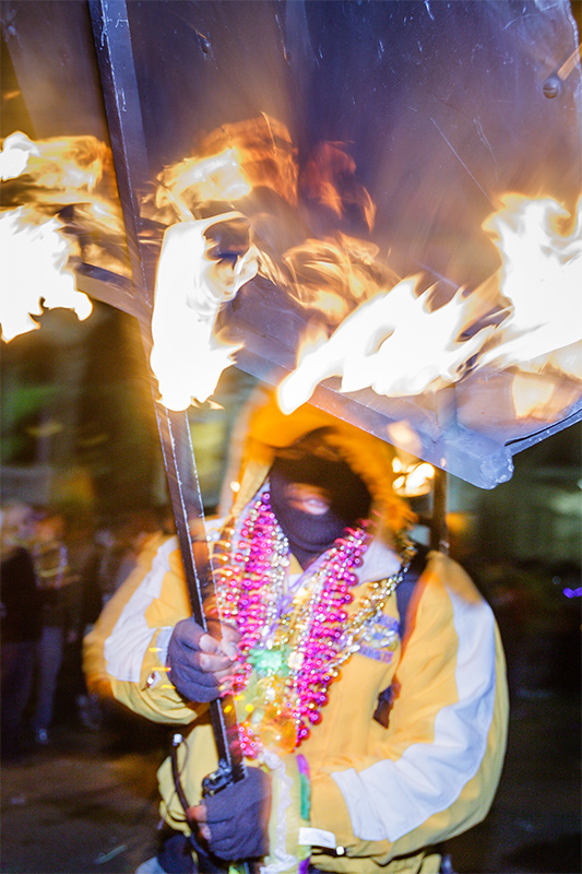 Flambeaux Carrier, Krewe of Muses,  New Orleans, Louisiana
